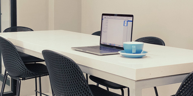 Flexible Desk in Daily Grind Coffee Shop and Coworking Space