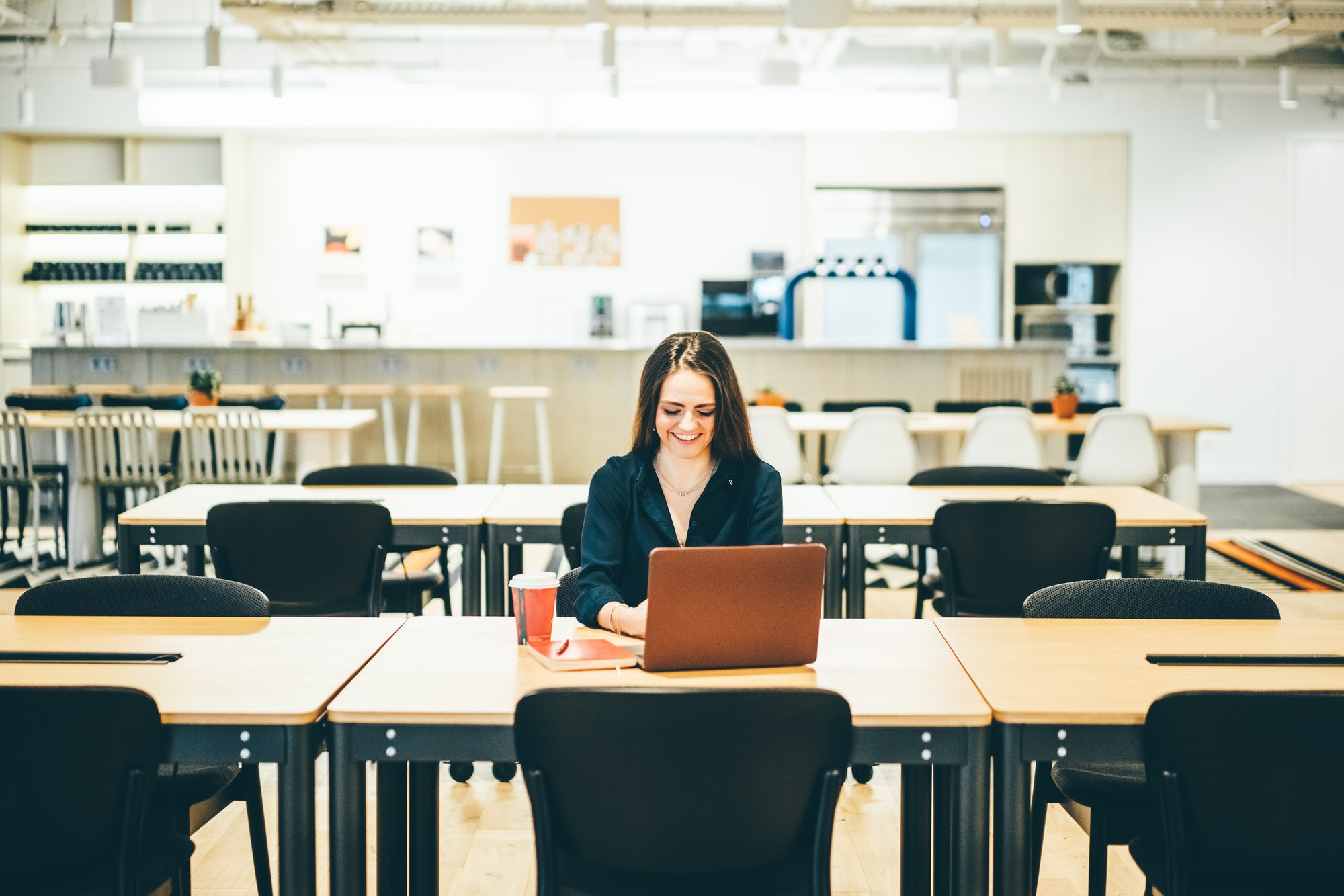 Woman working in a coworking coffee shop