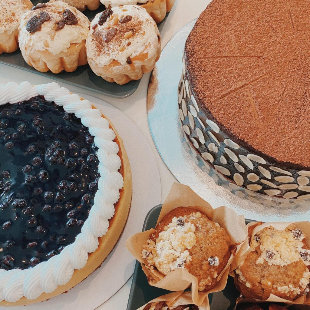 photo of cakes and pastries offered by the best coffee shop nearby, daily grind coffee shop