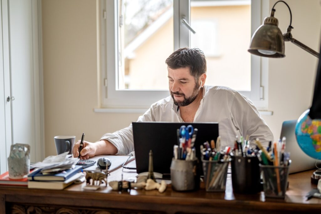 man working from home on a remote work setup