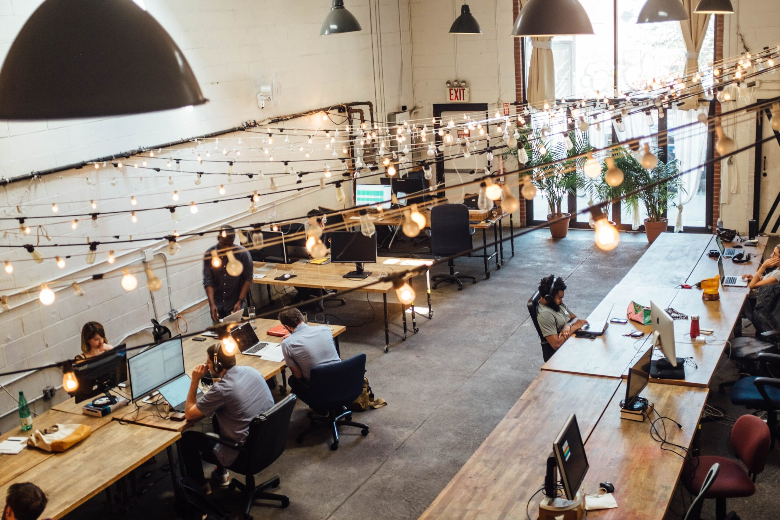 Professionals enjoying coworking space benefits