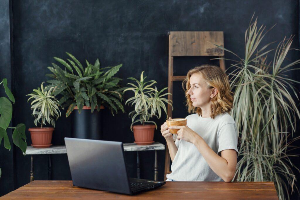 ergonomic work setup woman drinking coffee while working