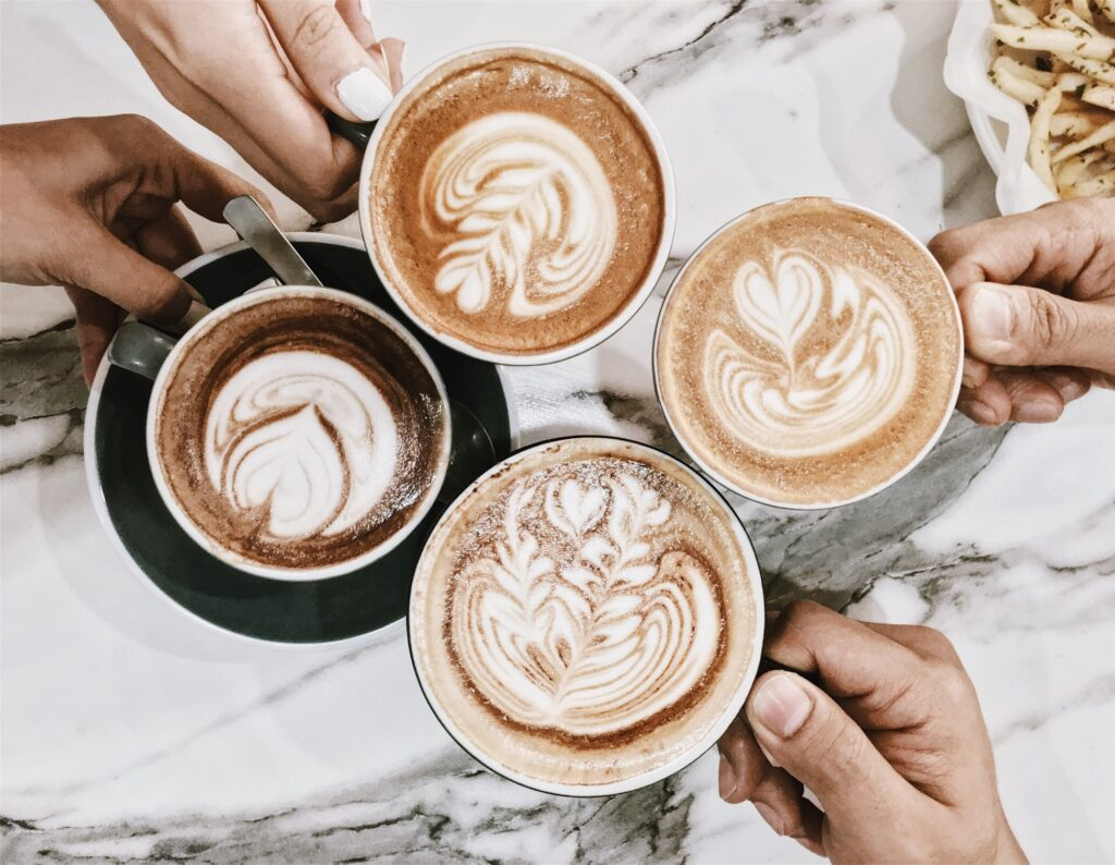 four friends enjoying cups of coffee